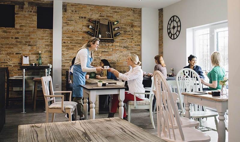 cafe shop worker serving tea